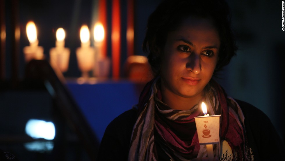 "APRIL 23 - NEW DELHI, INDIA: A girl holds a candle during a Greenpeace awareness campaign to save Mahan forest in the Indian state of Madhya Pradesh on <a href=""http://www.cnn.com/2014/04/21/opinion/sanderson-earth-day-cars/"">Earth Day,</a> April 22, 2014. Events were held worldwide to help preserve the environment, including demonstrations, planting trees and using minimal electrical power."