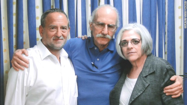 Alan Gross, center, visits with his wife, Judy, left, and attorney Scott Gilbert in 2013.