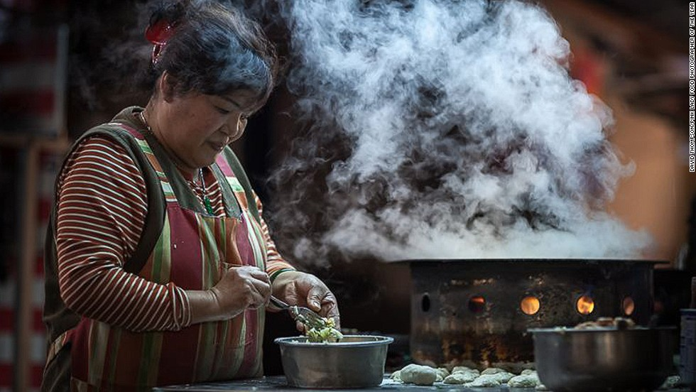 British photographer David Thompson took home top prize in the Food in the Street category for this image of a woman making jian bao dumplings.