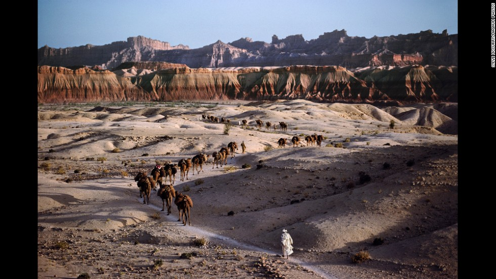 A camel caravan works its way across the rocky terrain in southern Afghanistan, 1980.