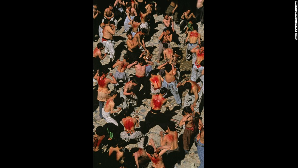 Shiite Muslims flagellate themselves during Ashura in Kabul, 2002.