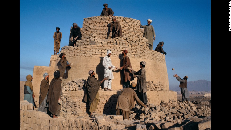 Men work to rebuild a damaged kiln in Kandahar, 1992.