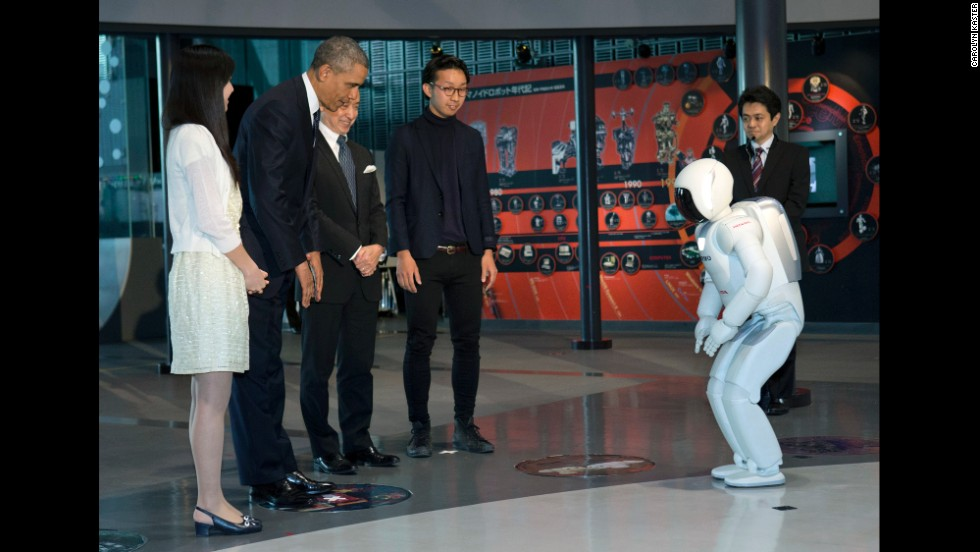 Obama and Honda Motor's humanoid robot ASIMO, an acronym for Advanced Step in Innovative Mobility, bow to each other during a youth science event at the National Museum of Emerging Science and Innovation in Tokyo on Thursday, April 24.