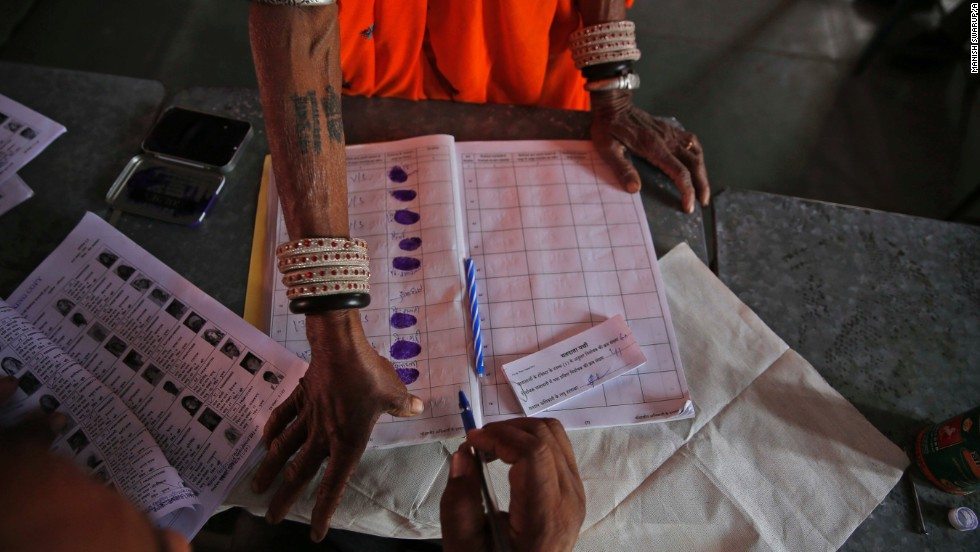 An Indian woman gives her thumb impression before casting her vote in a village near Sawai Madhopur on April 24.