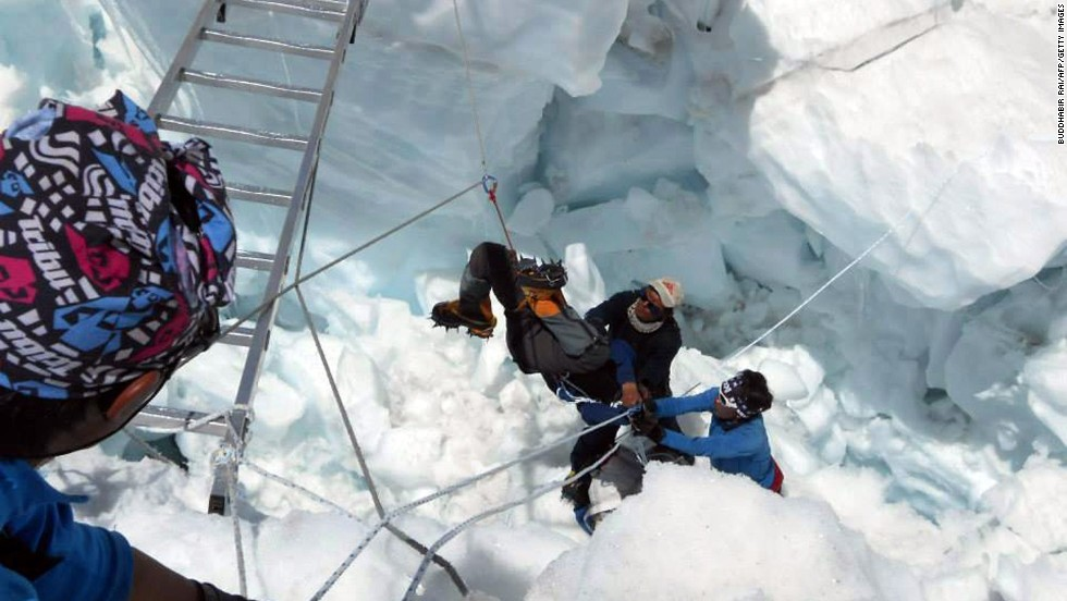 """A Nepalese rescue team retrieves a survivor of an avalanche on Mount Everest on Friday, April 18.  A high-altitude avalanche Friday killed 13 Sherpa guides and seriously wounded three in the <a href=""""http://www.cnn.com/2014/04/18/world/asia/nepal-everest-avalanche/"""">single deadliest accident on Mount Everest.</a>"""