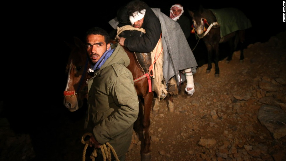 "Saleh Zawaraa, 28, arrives on horseback after being severely injured by a tank shell as he tried to bring bread into the Syrian village of Beit Jinn on Sunday, April 20. The United Nations says more than <a href=""http://www.cnn.com/2013/07/25/world/meast/syria-violence"">100,000 people have been killed in Syria</a> since the opposition launched anti-government protests in 2011."