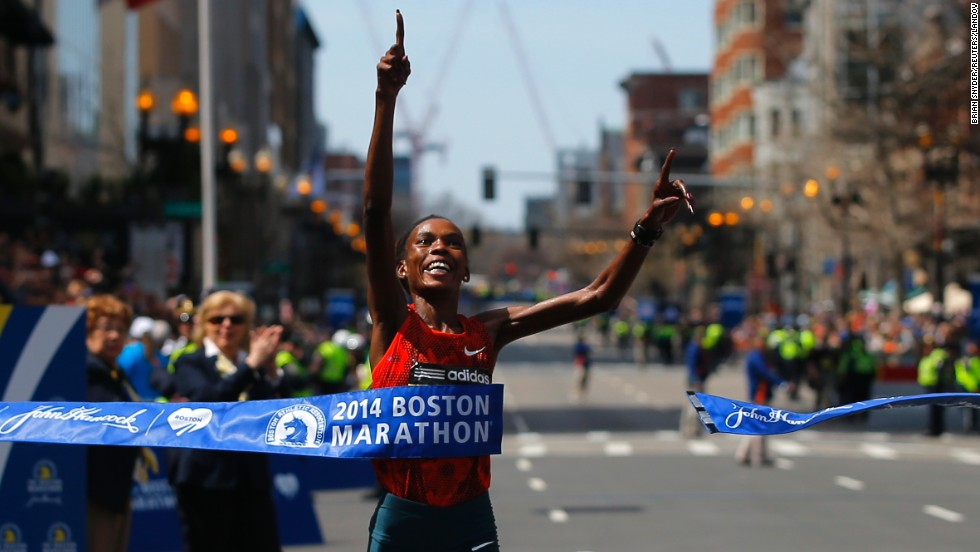 "Rita Jeptoo of Kenya breaks the tape to win the women's division at the <a href=""http://www.cnn.com/2014/04/21/us/boston-marathon/"">118th running of the Boston Marathon</a> on Monday, April 21. For Jeptoo, 33, it was a second consecutive victory. She again won the women's division with an unofficial -- and course record -- time of 2:18:57, <a href=""https://twitter.com/bostonmarathon"" target=""_blank"">according to the event's official Twitter account.</a>"