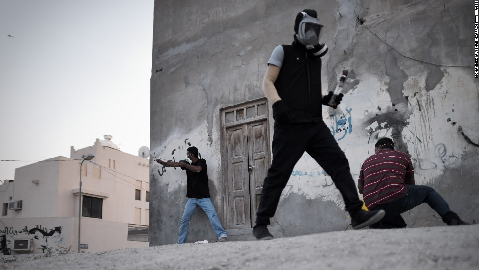 "On Tuesday, April 22, Bahraini protesters clash with riot police after the funeral of Ahmed al-Mosajen and Ali Abbas, who died when their vehicle exploded two days earlier. <a href=""http://www.cnn.com/2014/04/18/world/gallery/week-in-photos-0418/index.html"">See last week in 33 photos.</a>"