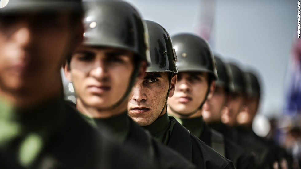 Turkish soldiers stand in line during the ceremony celebrating the 99th anniversary of ANZAC Day in the town of Canakkale, Turkey, on Thursday, April 24. ANZAC is the acronym for Australian and New Zealand Army Corps. The day originally marked the landing of soldiers from both nations at Gallipoli, Turkey, in 1915. In the eight-month campaign fought there, 2,721 New Zealanders and 8,709 Australians died before the allied forces withdrew. The day is now a tribute to those who have died in all conflicts.