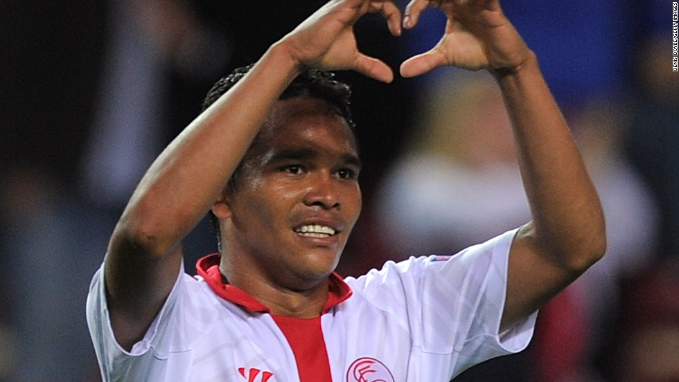 Carlos Bacca celebrates his goal in Sevlla's 2-0 win over Valencia in the Europa League last four clash.