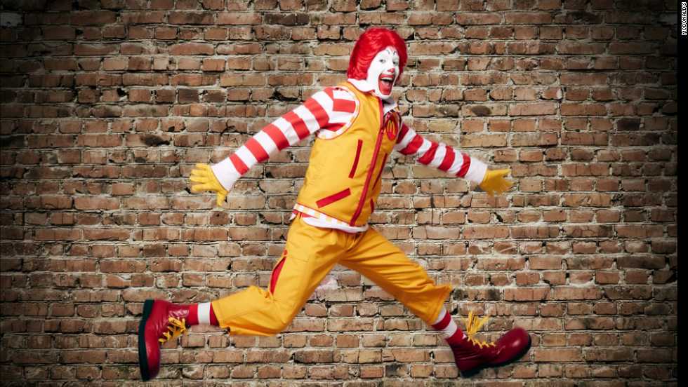 Behold! Ronald McDonald's big wardrobe makeover includes cargo pants, a technical vest, and a red and white striped rugby shirt.