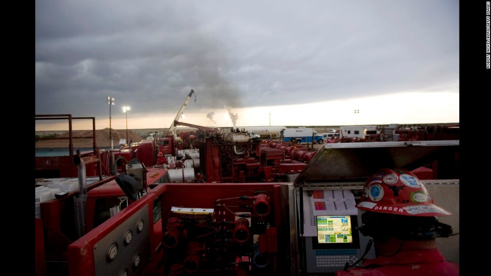 A Halliburton employee monitors a fracking operation outside Hope, New Mexico, in June 2007. Fracking, or hydraulic fracturing, is the process of breaking through dense shale to unlock natural gas.