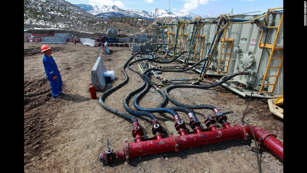 A worker monitors water pumping pressure and temperature at an Encana Oil & Gas fracking site in Rifle, Colorado, in March 2013.