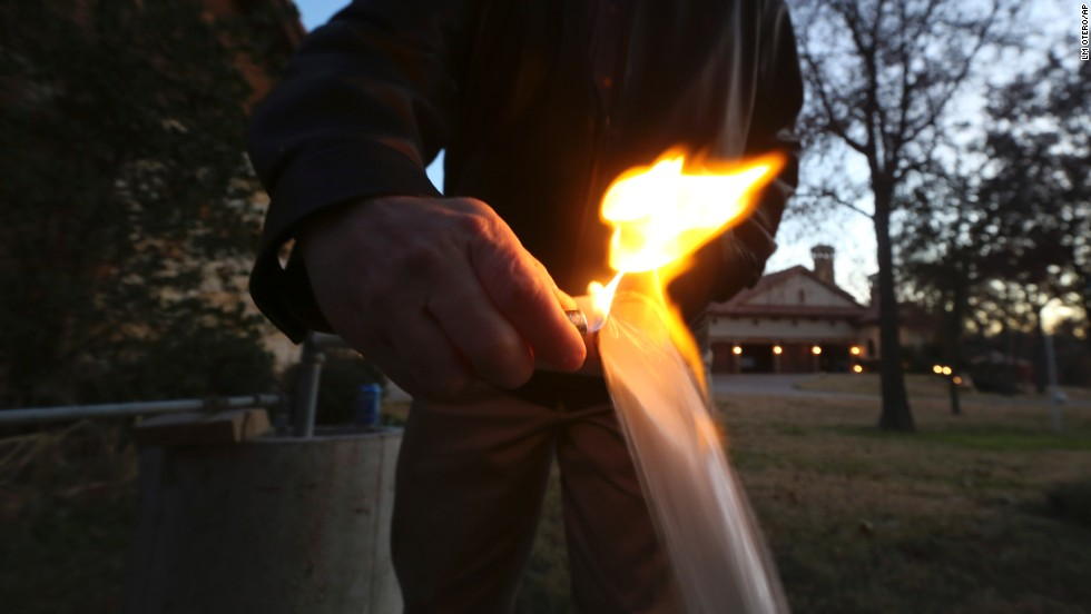 Steve Lipsky lights water flowing from a well spigot on his family's property in Parker County, Texas, near Weatherford, in November 2012. Lipsky says a fracking operation contaminated the well.