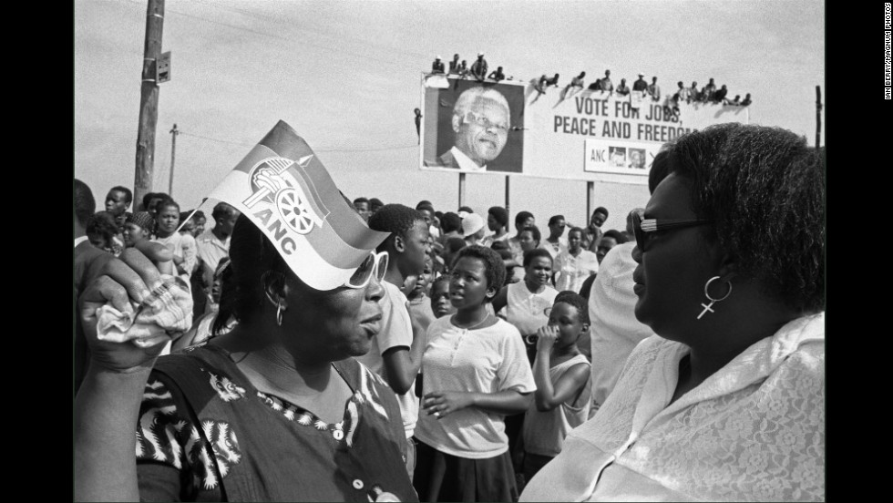 "Twenty years ago, South Africa made the final strides to ending <a href=""http://www.cnn.com/2013/12/06/world/africa/mandela-life-under-apartheid/"" target=""_blank"">apartheid</a> with the 1994 election, the country's first multiracial election. Magnum photographer Ian Berry documented the life of South Africans under apartheid, including the historic election that led to <a href=""http://www.cnn.com/SPECIALS/africa/nelson-mandela/index.html"" target=""_blank"">Nelson Mandela</a> being elected president.  Here, women await the arrival of  Mandela at an African National Congress rally."