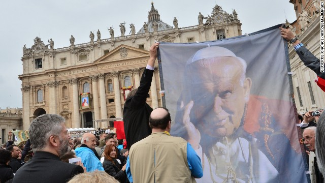 A banner showing Pope John Paul II is held during the canonisation mass of Popes John XXIII and John Paul II on St Peter's at the Vatican on April 27.