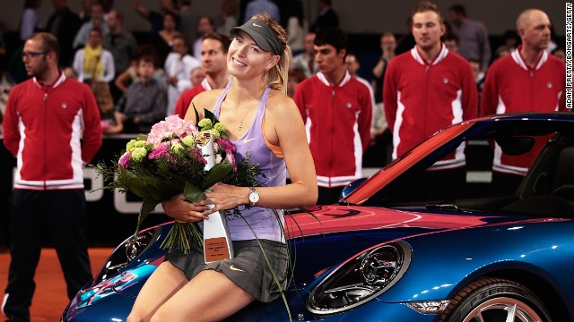 Maria Sharapova enjoys the spoils of victory after beating Ana Ivanovic in the Stuttgart final