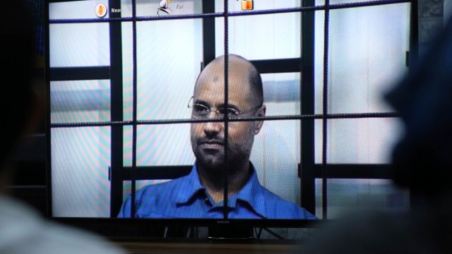 File photo: The second son of former Libyan leader Moammar Gadhafi appears via video link at a trial.