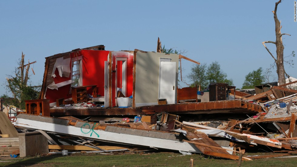 The remains of a home are seen in Baxter Springs on April 28. Sixty to 70 homes and at least 20 businesses there were reported destroyed, Allison said.