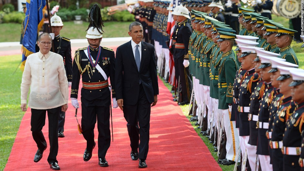 Obama walks with Philippine President Benigno Aquino III as they review an honor guard during a welcoming ceremony at the Malacanang Palace grounds in Manila on Monday, April 28.