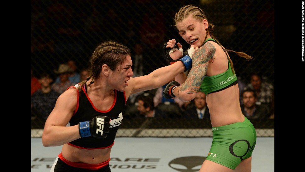 Bethe Correia punches Jessamyn Duke during UFC 172, which took place Saturday, April 26, in Baltimore. Correia won the bout by unanimous decision.