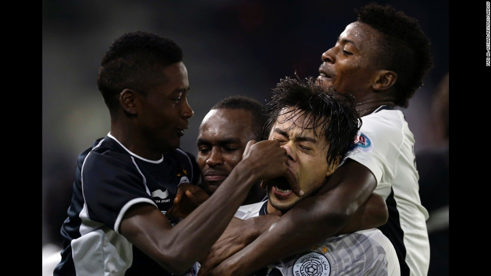Players with the Qatari soccer team Al-Sadd celebrate after scoring a goal against Al-Ahli during an AFC Champions League match in Doha, Qatar, on Tuesday, April 22. Al-Sadd won the game 2-1 to advance to the knockout stage of the tournament.