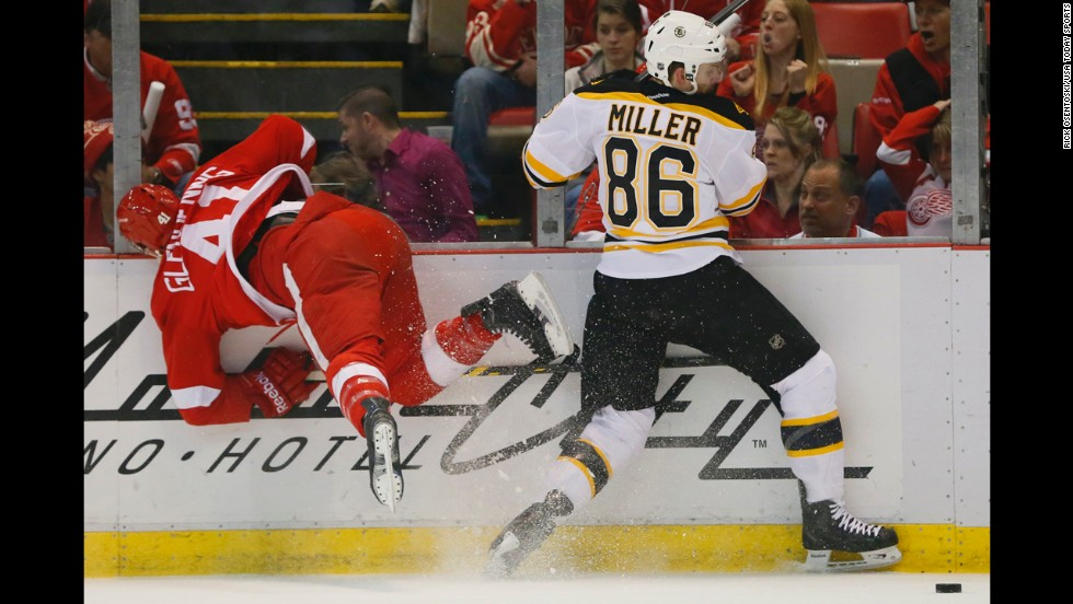 Detroit's Luke Glendening battles for the puck with Boston's Kevan Miller in Game 3 of the teams' first-round NHL playoff series on Tuesday, April 22. Boston, the defending Eastern Conference champions, won the game and later the series.