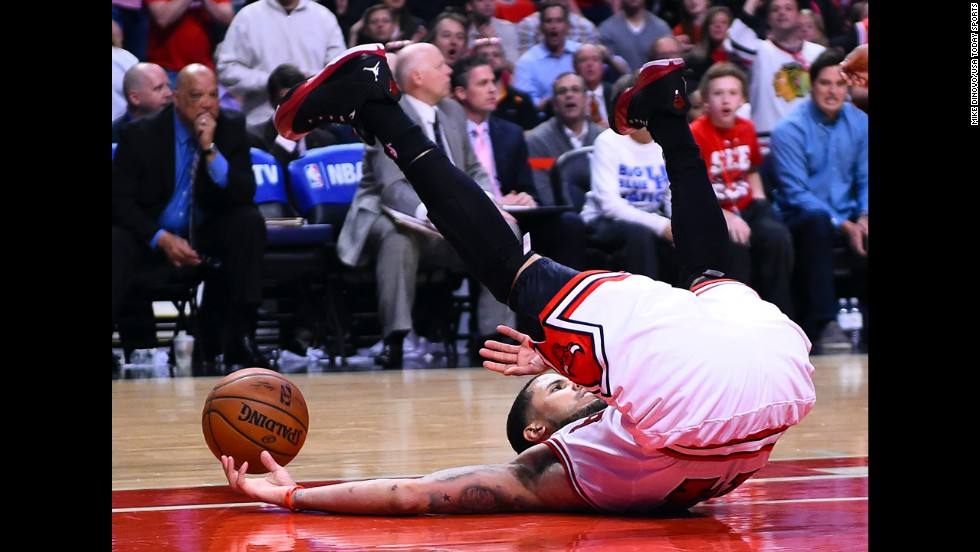 Chicago Bulls guard D.J. Augustin gets knocked to the floor Tuesday, April 22, in Game 2 of the first-round playoff series against the Washington Wizards. The Wizards won the game to grab a 2-0 series advantage.