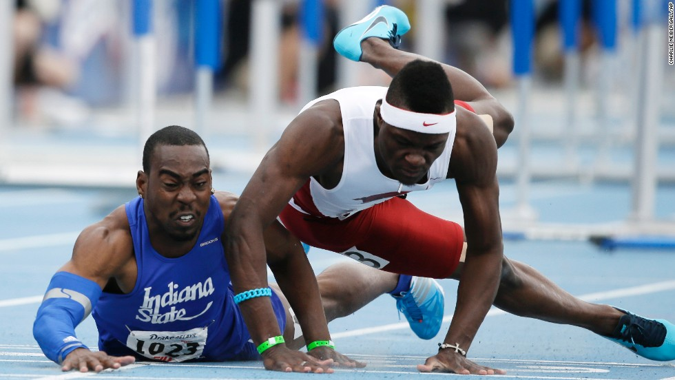 Indiana State's Greggmar Swift collides with Arkansas' Omar McLeod at the finish line of the 110-meter hurdles Saturday, April 26, at the Drake Relays meet in Des Moines, Iowa. Swift finished in second and McLeod finished in third.