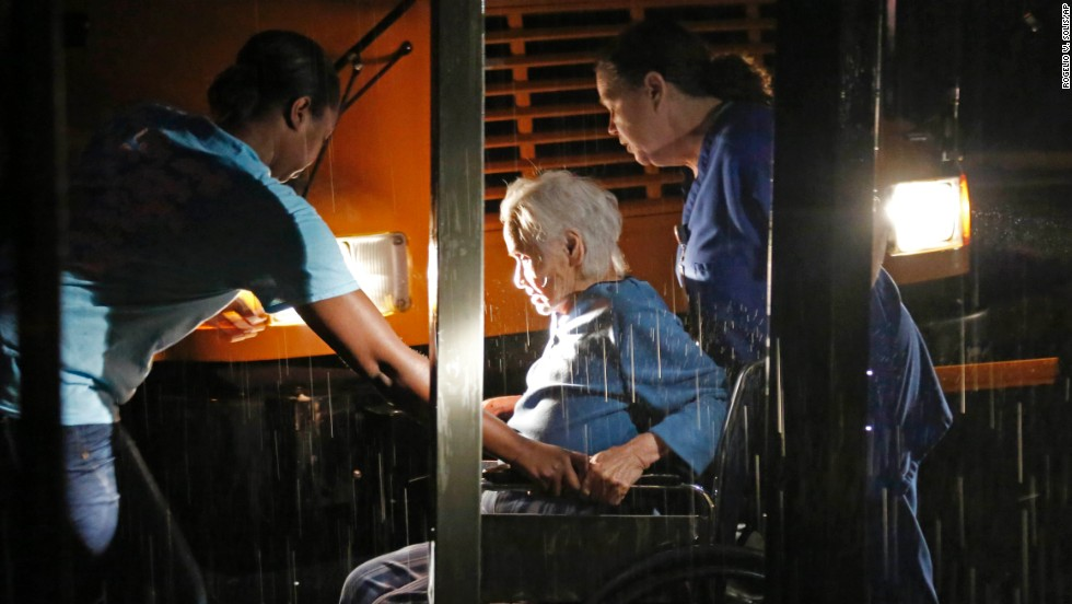 Workers assist a resident in Louisville on April 28. A nursing home and the Winston Medical Center, Louisville's major hospital, were among the buildings hit.