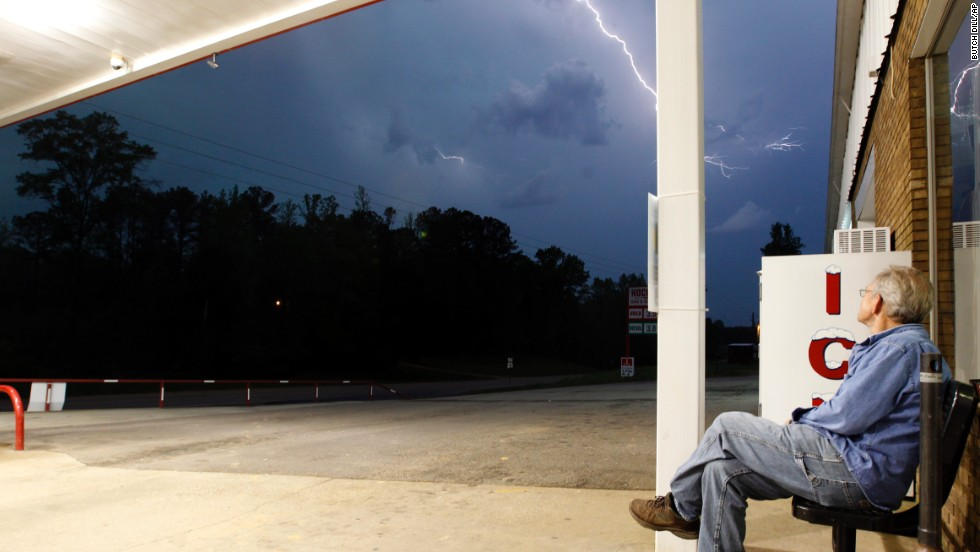 Jimmy Sullinger watches lightning as a storm approaches the gas station where he works in Berry, Alabama, on April 28. Alabama Gov. Robert Bentley declared a state of emergency for all counties.