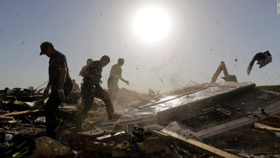 Dust and debris fly as workers flip a fallen wall while searching destroyed homes in Vilonia on April 28. Arkansas Gov. Mike Beebe said the storm was one of the worst to hit the state in recent memory.