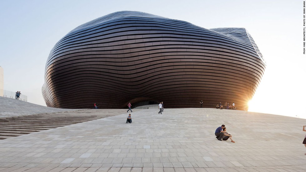 The Ordos Museum in Inner Mongolia designed by MAD Architects. The futuristic blob anchors the newly constructed desert city. It is covered in polished metal tiles that protect it from the frequent sandstorms.