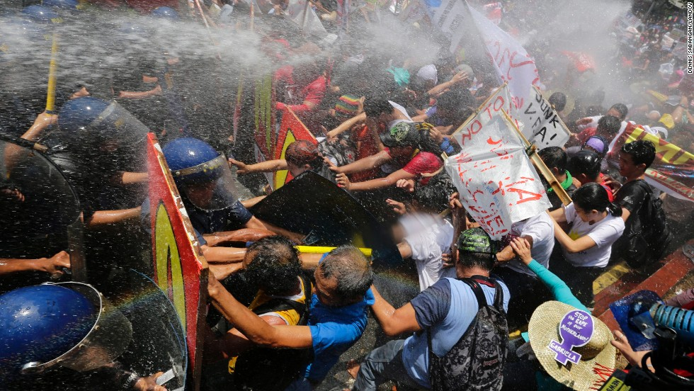 Filipinos protesting Obama's visit are dispersed by water cannon near the U.S. embassy in Manila on April 29.