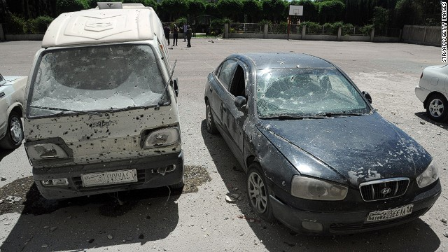 Shrapnel holes are visible on cars after a mortar attack Tuesday in the Syrian capital of Damascus.
