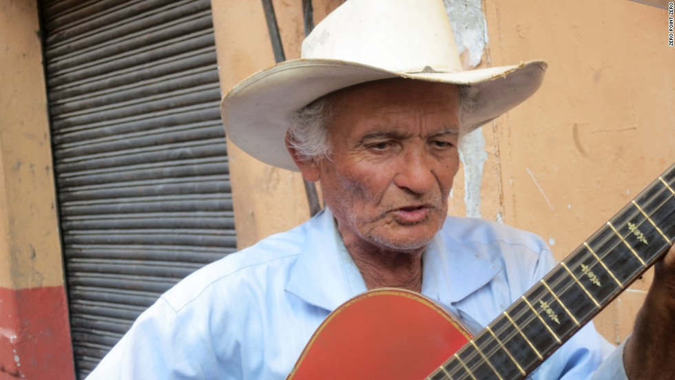 "A musician strums his guitar in the streets of Cuernavaca, Mexico. While in the city, Bourdain paid homage to the iconic Malcolm Lowry novel ""Under the Volcano."""