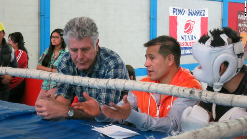 Bourdain watches a boxing match in Mexico City. He met an ex-boxer who fought his way out of poverty, not just for titles, but to support his family. The man now gives back by training the next generation of fighters.