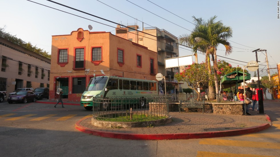People wait at a bus stop in Cuernavaca, which is the capital and largest city in the state of Morelos.