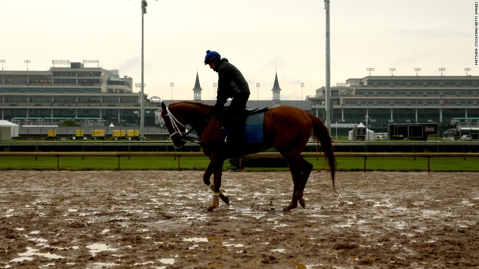 A horse is brought onto the track during a morning exercise session at Churchill Downs amid wet weather earlier in the week.
