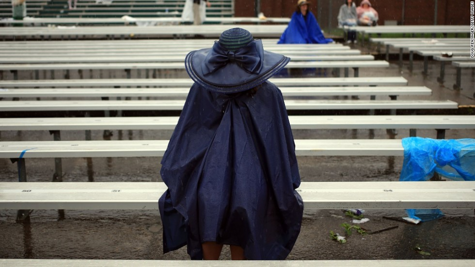 Last year half an inch of rain fell in the six hours before the race leading to fans to take innovative precautions to keep dry.