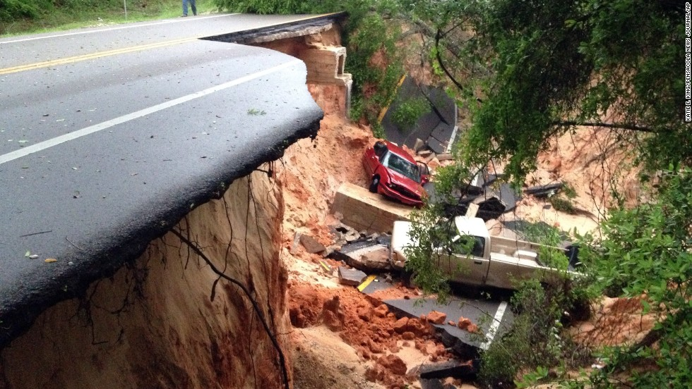 On Florida's Gulf Coast, torrential rains reduced some streets to rubble, gouged huge gashes in others and left stretches of others submerged. Here, vehicles rest at the bottom of a ravine after part of the Scenic Highway collapsed near Pensacola, Florida, on April 30.
