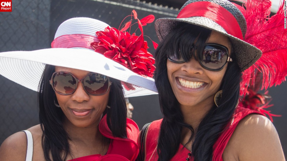 "Big glasses, big hats and big smiles. The derby is also referred to as ""The Run for the Roses"" for the <a href=""http://www.cnn.com/2014/05/01/sport/kentucky-derby-weather-story/"">garland of 554 red roses</a> draped over the winner."