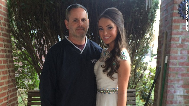 Senior Abby Rodgers, here with her father, went without a date to St. Basil Academy's prom in suburban Philadelphia.