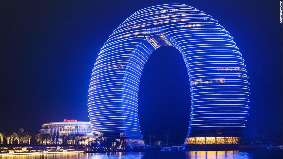 "<strong>Sheraton Huzhou Hot Spring Resort, Huzhou</strong><br /><strong>Architect: </strong>MAD architects<strong><br />Status: </strong>Opened in 2013<strong><br />Rooms: </strong>321<br /><strong>Fast fact:</strong> Constructed of ""layers"" of floors to create a ring that rises from the south bank of Huzhou's Taihu Lake, this $1.5 billion Sheraton hotel received a lot of attention on its opening for its unusual design. The local region is known for its beautiful scenery, which includes hot springs and bamboo forests; scenes from Oscar-winning ""Crouching Tiger, Hidden Dragon"" were filmed in Huzhou. <a href=""http://www.starwoodhotels.com/sheraton/property/overview/index.html?propertyID=3414"" target=""_blank""><em><br />Sheraton Huzhou Hot Spring Resort<em></em></a>, No. 5858 Taihu Road, Huzhou, Zhejiang, China; +86 572 2299 999</em>"
