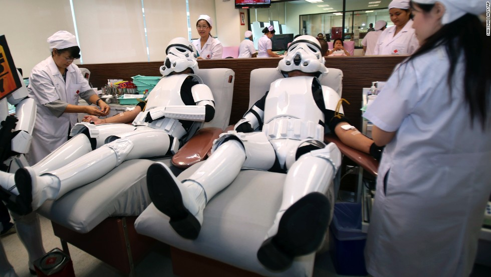 "Udomsak Ratanotayo, left, and Suttinan Boonsomkiat wear ""Star Wars"" stormtrooper costumes Monday, April 28, while donating blood at the Thai Red Cross in Bangkok, Thailand. Some fans of the movie franchise were donating blood and giving toys to a local orphanage ahead of Star Wars Day, May 4."