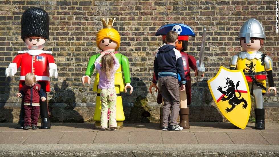 Children in London play with giant Playmobil figures on Wednesday, April 30, as the toy company celebrates its 40th anniversary.
