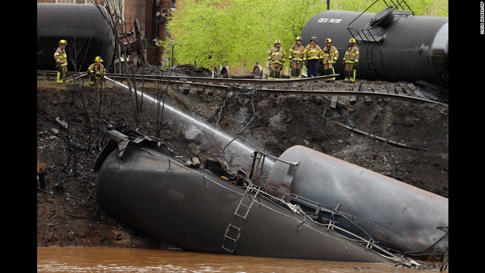 "Firefighters work along the train tracks where several tanker cars, carrying crude oil, <a href=""http://www.cnn.com/2014/05/01/us/virginia-train-derailment/index.html"">derailed and caught fire</a> near downtown Lynchburg, Virginia, on Wednesday, April 30. There were no injuries in the derailment, but the resulting fire sent a pillar of black smoke rising over the city and forced the evacuation of much of its downtown for several hours."