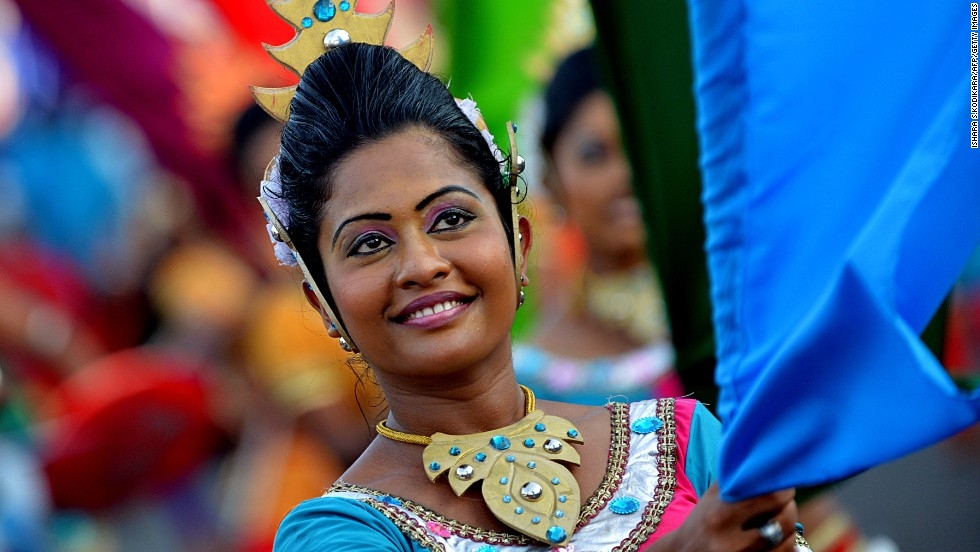 MAY 1 - COLOMBO, SRI LANKA: A Sri Lankan dancer participates in a pro-government May Day rally. Workers' groups from all over the world mark the occasion in honor of the international labor movement, campaigning for better working conditions and rights.