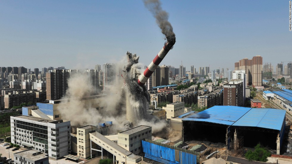 A 150-meter (492-foot) chimney in Shenyang, China, collapses after it is demolished by explosives on Monday, April 28. The chimney used to be part of a local heating factory, according to local media.
