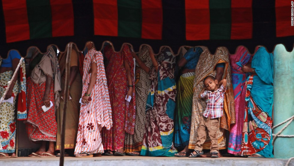 A boy waits with his grandmother as she stands in line to vote Wednesday, April 30, on the outskirts of Hyderabad, India. India's general election is being held in stages, with the vote counting to conclude May 16.